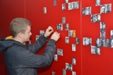Anatoli Slavov adds portraits on the photo wall at Lijssenthoek